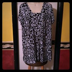 Black and white pullover blouse Black with white designs,  short sleeve, 95% polyester and I can't read the other 5%...bad eyes... Lol. Olivia paige Tops Tunics
