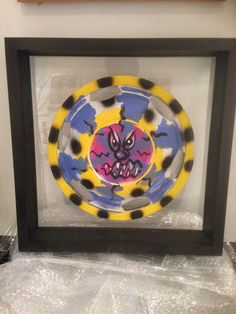 Painted hubcap by Kenny Scharf 1996