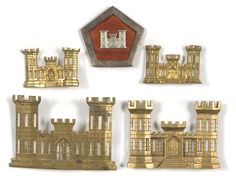 two large-sized stamped brass castles worn on the hat, and two identical, but smaller, castles worn on the dress collars under the 1851 regulations and probably also on the hat. Plus a rhomboidal silver metal device having a red velvet center and applied silver castle in stamped metal, likely proprietary insignia to a unknown unit.