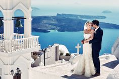 Santorini wedding photographer. A traditional greek wedding in Santorini, famed for blue skies, white and blue buildings and stunning vistas and sunsets.