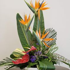 Send Tropical Day Flower Arrangement in Olympia, WA from Specialty Floral Design, the best florist in Olympia. All flowers are hand delivered and same day delivery may be available. Contemporary Flower Arrangements, Tropical Flower Arrangements, Creative Flower Arrangements, Church Flower Arrangements, Church Flowers, All Flowers, Purple Flowers, Spring Flowers, Lilies Flowers