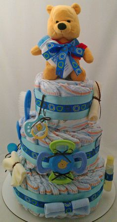 SALE - 20% Off  Winnie The Pooh 3 Tiered Diaper Cake. $52.00, via Etsy.