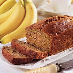 "BANANA BREAD: 1 cup whole wheat flour 1/2 cup all-purpose flour 1 teaspoon baking powder 1 teaspoon baking soda 1/8 teaspoon salt 1/4 cup ""measures-like-sugar"" calorie-free sweetener  2 tablespoons margarine, melted $ 4 medium-sized very ripe bananas, peeled and mashed  1 large egg, lightly beaten  Cooking spray"