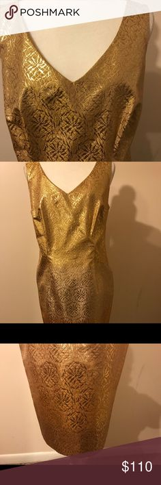 Escada Gold Tone Metallic Cotton and Silk Dress Beautiful Escada gold tone metallic and cotton silk dress.  New without tags,  size 10, but a snug fit. It is tapered at waist and around legs at bottom of dress. It is fully lined with hidden zipper closure. The gold tone is a little darker at the top and bottom of the dress (see pics). Dress is new, never been worn. Very nice. If you're a size 8, this dress will probably be a better more comfortable fit. European size 40 is equivalent to U.S…