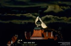The moon rises over the city hall of Östersund, Sweden
