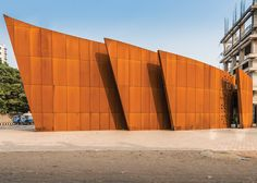 Sanjay Puri uses weathering steel to create layered facade for The Crescent office block.