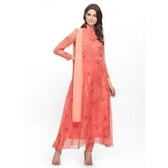 Look and feel beautiful in this pink tonal floral print chiffon bias cut suit which has a band collar and full fitted sleeves. It is paired with a crepe pink churidar and a chiffon peach dupatta to carry along. Clothing Websites, Print Chiffon, Dress Cuts, Churidar, How To Feel Beautiful, Kurtis, Floral Prints, Peach