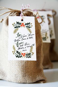 Homemade jam in burlap bag with what looks to be a Rifle Paper Co. gift tag. It's cute enough to make me want to start canning again.