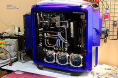 Cosmos II:CROW Engine | Inside and out, this computer build is spectacular. Inside, the tubing is either chrome or nickel plated to show off the tube runs. The lower fans are accentuated with custom fan surrounds. Outside, the extra thick radiator is mounted to show off its cooling prowess and even it has the overall unique blue paint job that makes the case stand out.