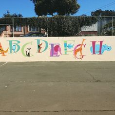 Playground mural designed by Etsy artist, painted by volunteers led by Shannon…