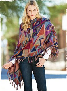 Kaffe Fassett's art knit is a collage of triangles, hand-loomed in dozens of shimmering tweeded pima hues—from sky blue and cornflower to olive, ochre, magenta and burgundy. Designed to fall asymmetrically, with fringed hem.