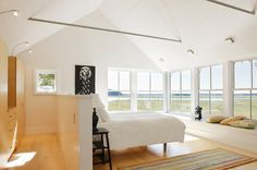 Modern Bedroom by Estes/Twombly Architects, Inc. half wall behind bed to move bed into center of room and closer to beautiful view