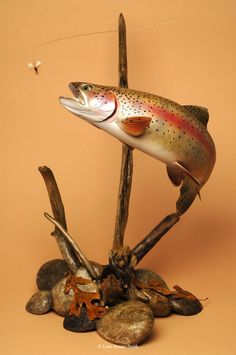 "Wooden Trout Trout Carvings by By Lona Hymas-Smith wish I had found these years ago, my dad would have loved them in his ""man cave"", along with all his fly fishing books and paraphernalia. Fly Fishing Books, Fly Fishing Tips, Trout Fishing, Fishing Gifts, Ice Fishing, Bass Fishing, Fish Mounts, Spotted Dog, Fish Art"