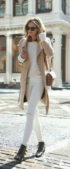 Camel coat over white sweater and jeans.