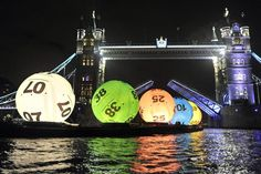 6 giant balls on the River Thames to publicise National Lottery ticket price rise #guerilla http://arcreactions.com/usb-memory-sticks-2/