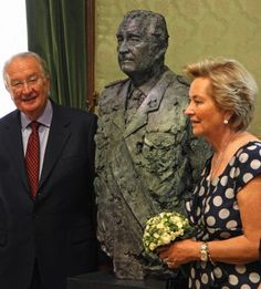 King Albert II, left, and Queen Paola, pose next to a newly unveiled bust of him, at the Belgian Senate in Brussels, 16 July 2013.