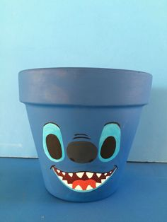 Stitch flower pot on Etsy listing at https://www.etsy.com/listing/458430998/stitch-inspired-hand-painted-terra-cotta