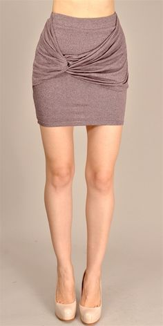 This stretch jersey mini skirt features draped bands with ruched detail at hip.Fully lined.