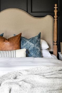 A plain, dated master bedroom gets a modern vintage makeover with moody black paint, modern textures, vintage style furniture, and budget DIY projects.