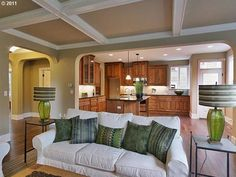 spacious, open living space into kitchen.