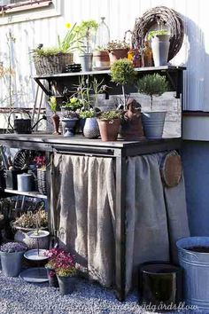 ♕ I have a potting bench very much like this one ~ I LOVE this skirt idea