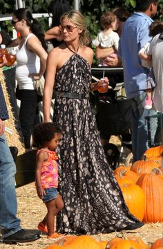 Heidi Klum Print Dress - Heidi Klum visited the pumpkin patch in Beverly Hills with her children wearing an elegant halter maxi dress with an artistic leopard print.