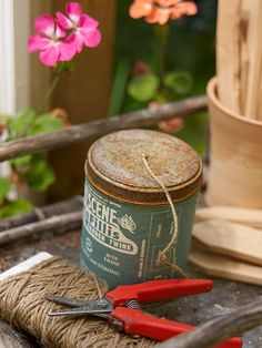 Keep twine in an old tin with a drilled hole on top