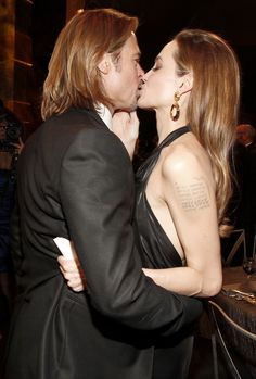 Brad Pitt and Angelina Jolie's Cutest Couple Moments - At the Screen Actors Guild Awards, 2012 from InStyle.com