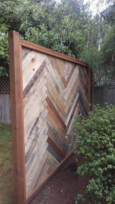 """I made this section of fence out of the slats of eight pallets, a 10' 4""""x4"""" treated post, two 8' (approximate) 2""""x4"""" treated boards, and approximately 50' of 1""""x1"""" treated boards around the perimeters and a box of #8x1 1/4""""…"""
