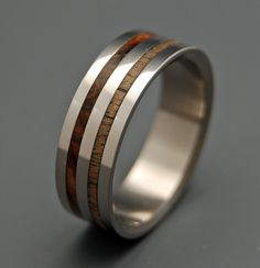 Bountiful. Twin bands of Dark Cocobolo and Koa wood encirle a durable titanium band, polished to a mirror finish. Pictured at 7mm.
