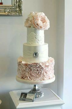 wedding cakes blush a white and blush wedding cake with a ruffle flower tier, lace and a brooch with a rhinestone plus large blush sugar blooms on top - Weddingomania Bling Wedding Cakes, Fondant Wedding Cakes, Wedding Cakes With Flowers, Beautiful Wedding Cakes, Gorgeous Cakes, Wedding Cake Designs, Pretty Cakes, Fondant Cakes, Cupcake Cakes