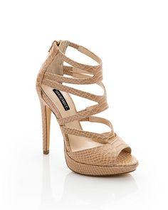 Neutral Strappy Snakeskin Heels | totally makes colored or denim skinnies a little bit more sexy. great day to night heels