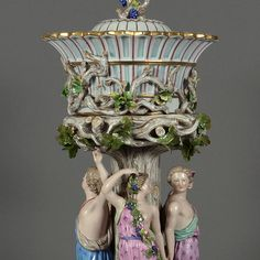 Large Figural Centerpiece  Meissen, swords underglaze blue, a lower edge, polychrome and gold decoration, on round with rocaille decorated naturalistically fully molded base tree stem with four fully three-dimensional figures in the antique style of Gäst crown-mounted tray top with canopy cover, remaining invisible., H 59 cm, utterly rare shape and highly decorative swords pommel end of 19 Century