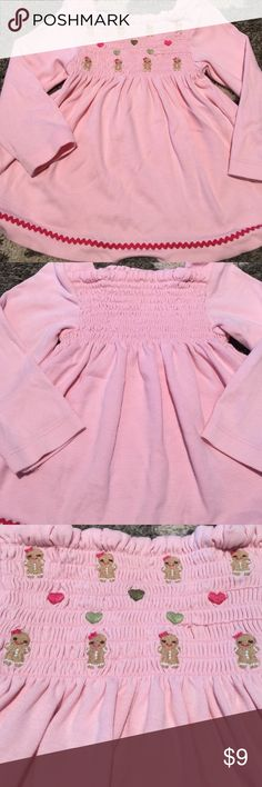 Gymboree Smocked Gingerbread Girl Top Gymboree Smocked Gingerbread Girl Top in size 12-18 months. 100% cotton. Has one TINY pull on the Gingerbread area (see pic 3) which is hardly noticeable and could possibly be fixed if you sew(?) No holes/tears/stains. Gymboree Shirts & Tops