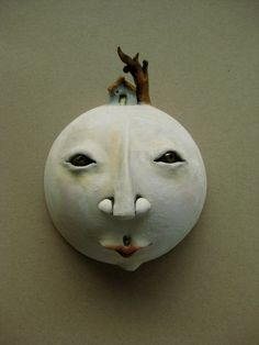 Ceramic wall mask with tiny house and tree by Debra Powell at MyLittleBetty, $85.00