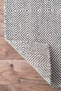 "Set a chic, mid-century foundation for your stylish space with this ivory area rug, showcasing a concentric diamond motif. Made in India, this area rug is hand-tufted from a wool and cotton blend in a 0.5"" pile – perfect for rolling out in fashionable living rooms or digging your toes in right out of bed in the morning. Easily vacuumed or spot cleaned for effortless upkeep, this rug performs best when paired with a rug pad to prevent shifting and sliding."