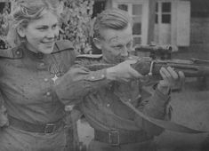 Sniper Sergeant R. G.Shanina gives a few pointers to her commanding officer, Major Banayev.