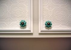 Textured cabinets with custom knobs. An easy and inexpensive way to make over your built ins