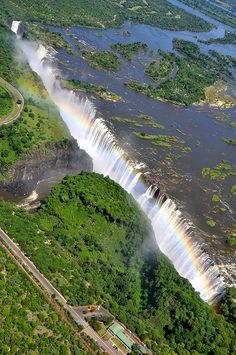 Victoria Falls, known by the local Kololo tribe as Mosi oa Tunya, The Smoke that Thunders, is one of the Seven Wonders of the World and is the largest waterfall in the world. Amazing Nature Photos, Nature Pictures, Beautiful Waterfalls, Beautiful Landscapes, Places To Travel, Places To See, Chobe National Park, Largest Waterfall, Africa Travel