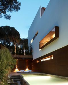 Casa Cubo is a modern hillside refuge designed by architect Octavio Mestre, whose project concept was inspired by Le Corbusier, located in Girona, Spain. Maple Wood Flooring, Interior Decorating, Interior Design, Le Corbusier, Ground Floor, Outdoor Spaces, House Design, Mansions, Landscape