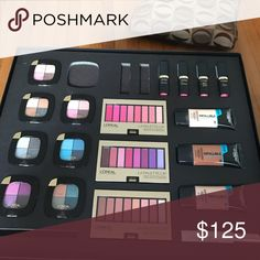 L'Oréal Paris make up kit. Includes: 7 eye shadow quads (2 Avenue de Roses, Acant Garde Azure, Haute Hazel, Vilet Amour, Silver Couture & French Biscuit) 3 lip palette's (Pink, Plum and Nude), 4 lipsticks (Liya's Pink, Eva's Pink, Doutzen's Pink and Blake's Pink)  3 foundations (Classic Ivory, Cocoa and Sand Beige) and one voluminous primer. loreal  Makeup