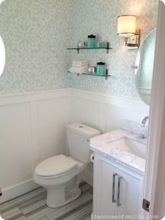 Powder room with wallpaper and marble floors - sconces  to side of oval mirror if space is cramped b/w mirror and side wall