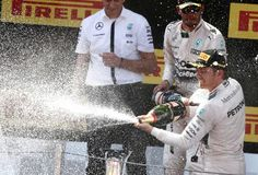 Winner Mercedes driver German's Nico Rosberg sprays sparkling wine on the podium after winning the Spanish Formula One Grand Prix at the Barcelona Catalunya racetrack in Montmelo, just outside Barcelona, Spain, Sunday, May 10, 2015. Photo: Andres Kudacki, AP / AP