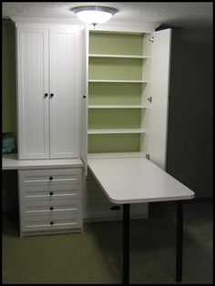 Hide away table- there when you need it, gone when you don't, AND with more storage shelves behind the table, all concealed in a nice neat cabinet!