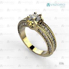 Anillo de compromiso en oro amarillo de 14 o 18 kilates con diamante central y diamantes a los costados.