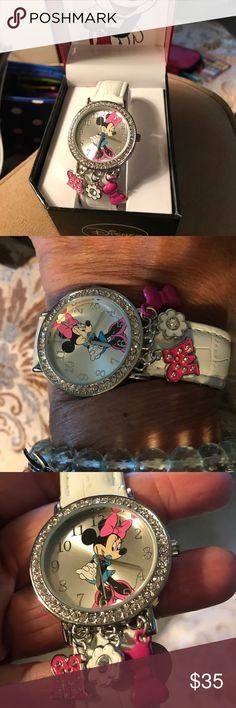 Disney Minnie watch Disney Minnie watch with white band and three hanging charms, New in box never used Disney Jewelry