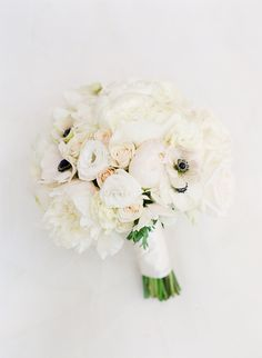 Ivory peony, rose and anemone wedding bouquet: Read More on SMP: http://www.stylemepretty.com/2016/09/13/white-navy-gold-wedding/