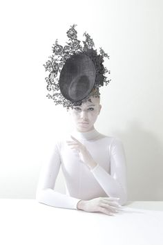 Philip Treacy; more optical illusion cleverness, the lace extends the domain of the brim without visually weighing down the hat. Nice contrast of textures too…..