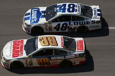 Dale Earnhardt Jr., driver of the #88 National Guard Chevrolet, leads Jimmie Johnson, driver of the #48 Lowe's / Valspar Reserve Chevrolet, during the NASCAR Sprint Cup Series Aaron's 499 at Talladega Superspeedway on May 4, 2014 in Talladega, Alabama.  http://www.pinterest.com/jr88rules/nascar-2014/ #NASCAR2014