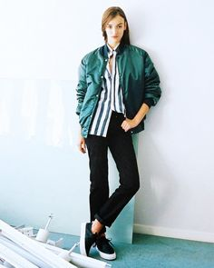 Eytys sneakers pair well with a striped shirt, bomber jacket, and basic black jeans
